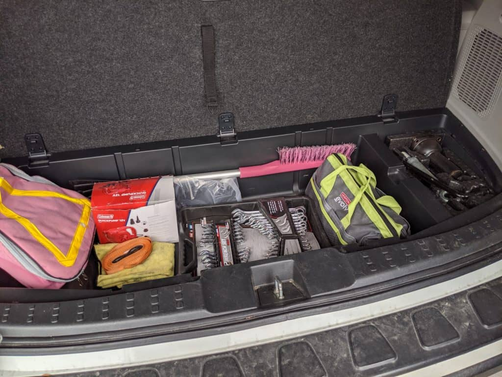 care emergency kit checklist for winter and summer that includes a roadside kit, ice scrapper, tools, straps and more