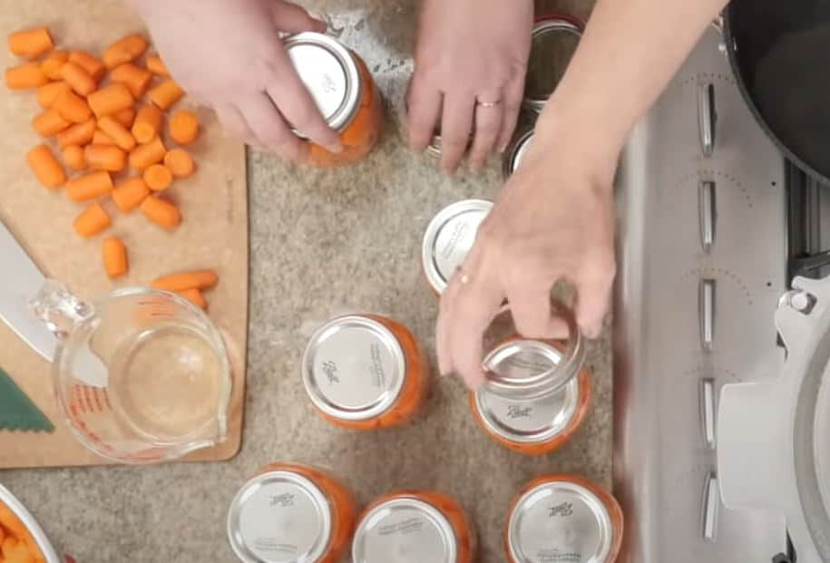 tightening lids on jars and then place in pressure canner